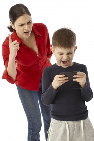5850309-s-little-boy-playing-with-mother-s-pda